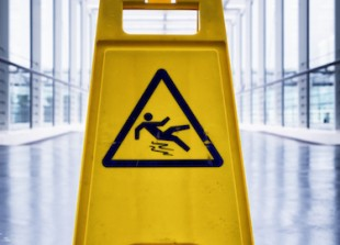 caution wet floor sign at a corridor
